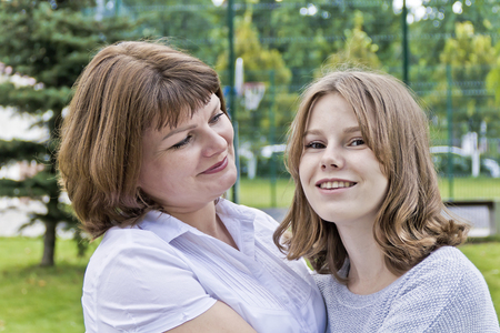 Happiest mother and daughter fourteen years old in summer time