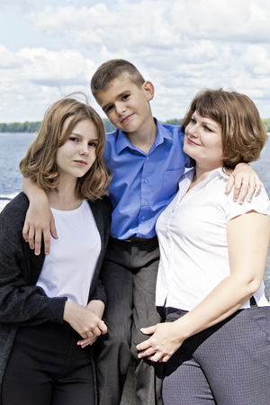 Happiest mother with daughter and son in summer time