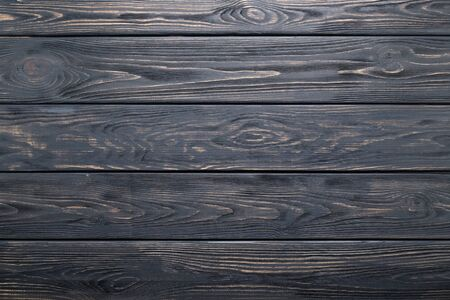 Dark gray background of wooden old rustic table, planks texture, wood wall.