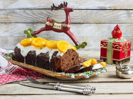 Christmas chocolate cake with oranges. Selective focus Reklamní fotografie