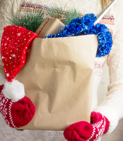 christmas shopping bag: Christmas shopping bag in womens hands. Stock Photo