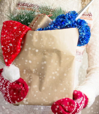 christmas shopping bag: Christmas shopping bag in womens hands. Over snow effect Stock Photo
