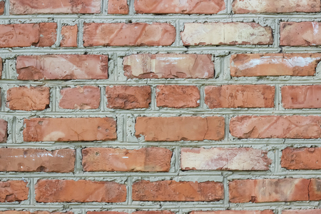 Old brick wall, old texture of red stone blocks closeup Stock Photo