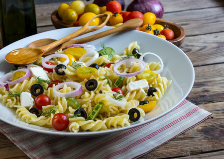 Greek Salad with Pasta. Selective focus Stock Photo