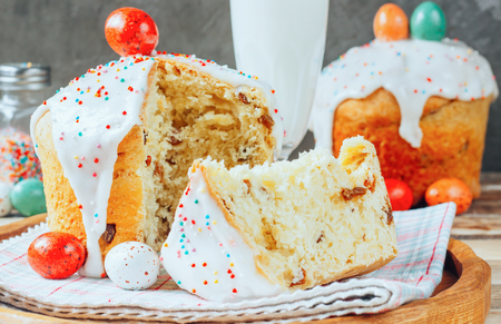 Easter composition with orthodox sweet bread, kulich and eggs on rustic wooden
