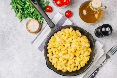 Mac and cheese, american style macaroni baked pasta with cheesy sauce in pan