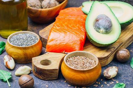 Animal and vegetable sources of omega-3 acids as salmon, avocado, linseed, oil, nuts, chia seeds, spinach. Zdjęcie Seryjne