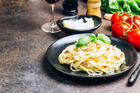 Pasta alla carbonara. Pasta spaghetti with bacon, egg, parmesan cheese and basil. Traditional italian cuisine.