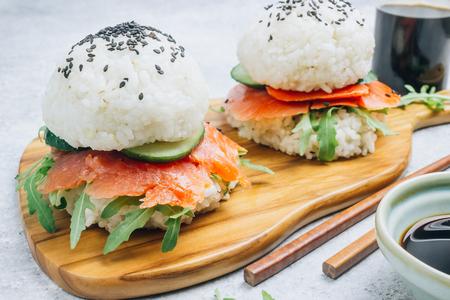 Homemade asian style gluten free sushi salmon burger on light gray Stock fotó