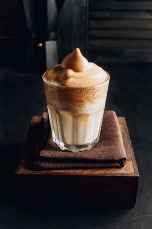One glass of Korean Dalgona coffee with oat milk on dark