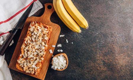 Coconut flour banana cake on dark background. Gluten free diet. Healthy food concept. Reklamní fotografie