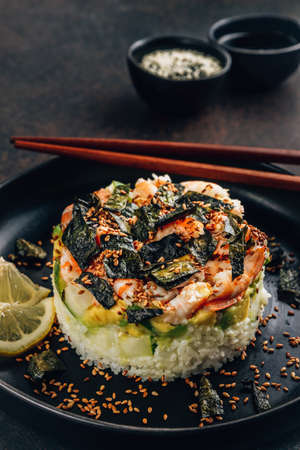 Spicy shrimp sushi stacks with layers of sushi rice, cucumbers and avocado spicy shrimp and furikake