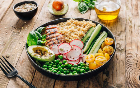 Healthy salad bowl with quinoa and chicken. Food and health.