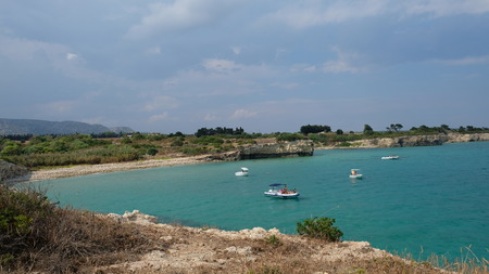 Amazing beach at the Ionian Sea, in the province of Syracuse, Sicily. The beach is part of the Oriented Nature Reserve Cavagrande.