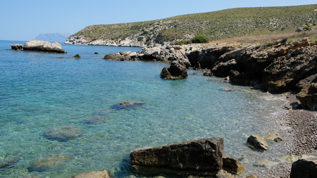 Cala Bianca, Province of Trapani, Sicily. Cala Bianca is a hidden, beautiful cove between the towns of Scopello and Castellammare del Golfo. The name came from the white color of the gravel. Stock Photo