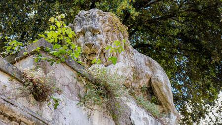 Rome, Villa Borghese gardens. Amazing statue of a lion, at the top of the Mostra dell'Acqua Felice.