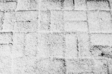 Fluffy snow lies on the dark tile. Textured abstract backgroun Standard-Bild