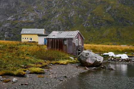Remote boat house at the coast in Vinstad on Lofoten Islands in Norway.