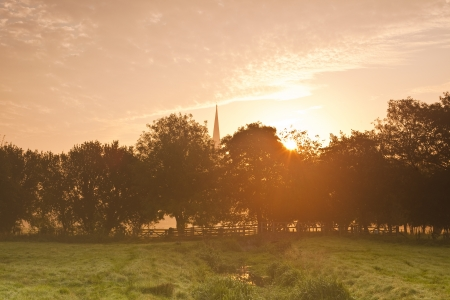 Salisbury cathedral and the water meadows at dawn. photo