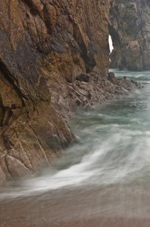 durdle door: Water swirling around Durdle Door in Dorset. Stock Photo