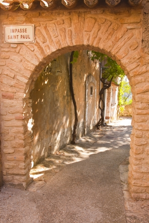 Ancient archway in Venasque, Provence. photo