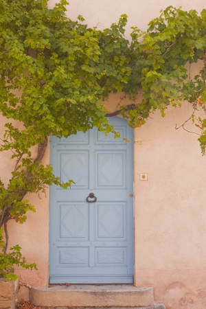 Typical provencal doorway in the village of Venasque. photo