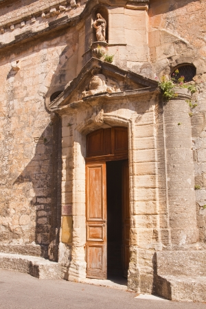 The door to the church in Venasque, Provence. photo