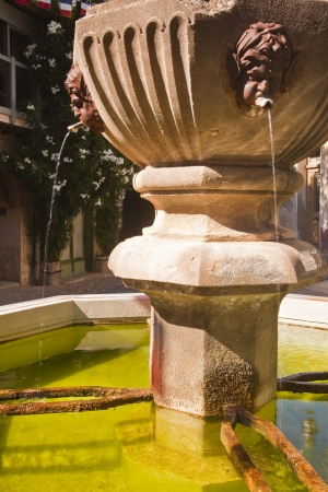 A small fountain in the village of Venasque in Provence. photo