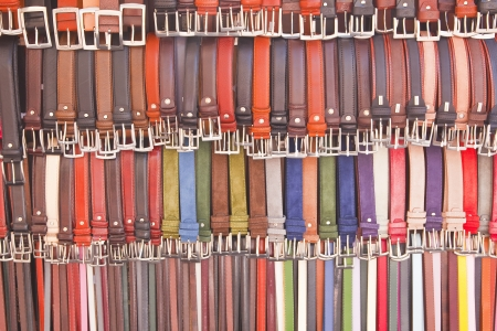 Abstract shot of belts on sale at a market in Florence, Italy. photo