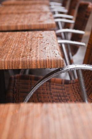 Cafe chairs under the rain  photo