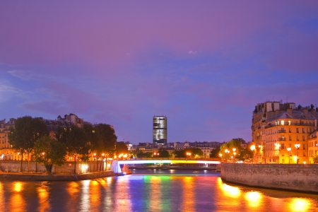 cite: Ile de la Cite and Ile Saint Louis in Paris lit up at night. Stock Photo