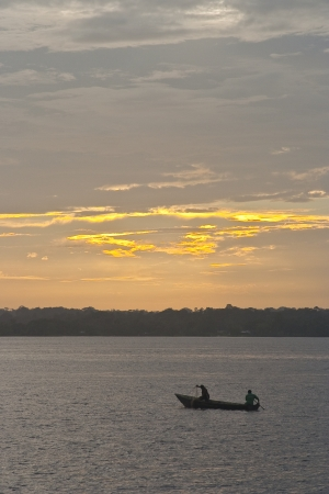 maroni: A boat on the river Maroni in French Guiana. Stock Photo