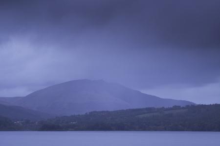 Derwent Water under heavy rain clouds in the Lake District national park.