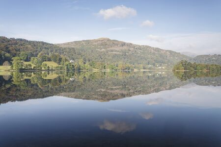 The still water of Grasmere in the Lake District national park, Cumbria, England. Stock Photo