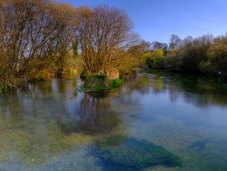 Ovington, UK - April 1, 2019:  The River Itchen in spring at Ovington, Hampshire, UK