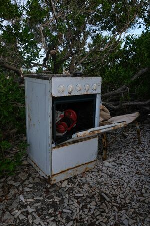 Old rusty oven in the outside with a red lantern inside of it Stockfoto - 131854870