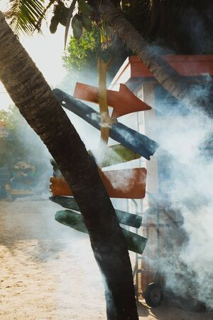 Arrow signs surrounded by smoke in bright colors