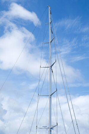 The mast of a big sailing vessel against the blue sky
