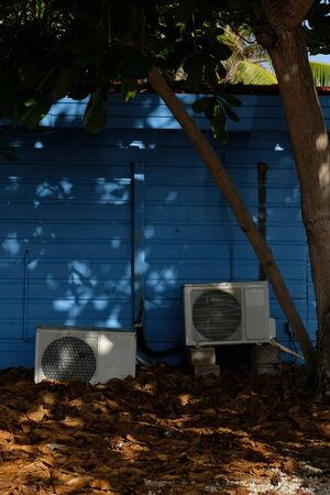 Old air conditioning units behind a house in Bonaire