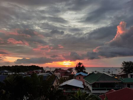 Dramatic pink sunset with rooftop view in Malapascua Philippines