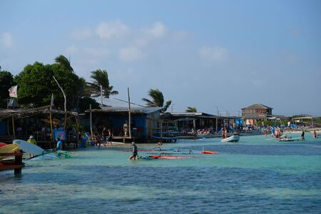 Shore view with partially cloudy sky of Jibe City windsurfing in Bonaire