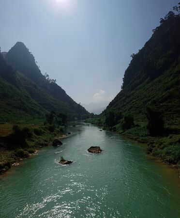 Crossing a river in North Vietnam during the Ha Giang Loop Imagens