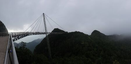 Skybridge tourist attraction on a foggy day in the mountains in Langkawi, Malaysia