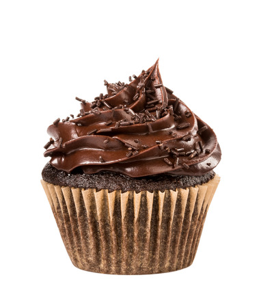 Chocolate cupcake with sprinkles  isolated on white. Foto de archivo