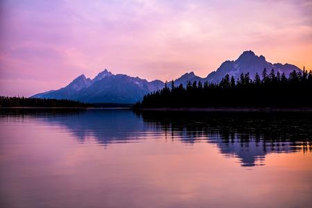 Grand Teton mountain range at sunset, Jackson Lake, Grand Teton National Park, wyoming, USA
