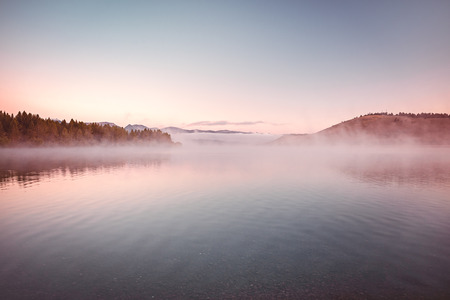 serene landscape: Mist and low morning clouds at Hebgen Lake, Montana, USA Stock Photo
