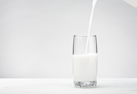 A white bottle of Milk over a white background