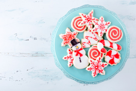 christmas backgrounds: Red and White Christmas Sugar Cookies on a plate