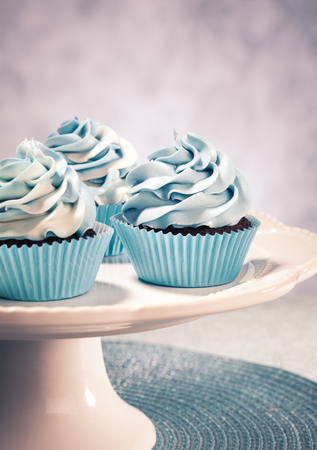 pearl tea: Blue Cupcakes on a cake plate. Vintage style. Stock Photo