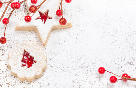 Christmas Linzer cookies decorated with icing sugar